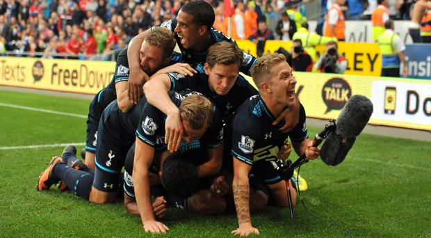 Tottenham Hotspur's Paulinho celebrates with his team mates after scoring their side's winner