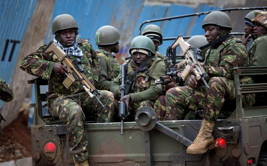 Trucks of soldiers from the Kenya Defense Forces arrive outside the Westgate Mall in Nairobi, Kenya