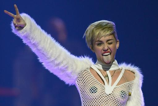 Entertainer Miley Cyrus winks and sticks out her tongue as she performs during the iHeartRadio Music Festival at the MGM Grand Garden Arena on September 21, 2013 in Las Vegas, Nevada. (Photo by Ethan Miller/Getty Images for Clear Channel)