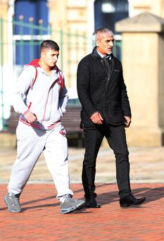 Aftab Khan (right) arriving at Bradford Crown Court