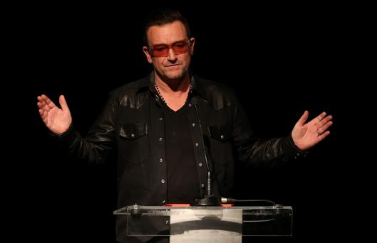 Bono makes a speech at the Amnesty International Ambassador of Conscience award for 2013 at a ceremony in the Mansion House Dublin. PRESS ASSOCIATION Photo. Picture date: Tuesday September 17, 2013. See PA story IRISH Malala. Photo credit should read: Niall Carson/PA Wire
