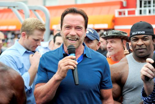 Arnold Schwarzenegger hosts a special body building experience at the famed Muscle Beach Venice.