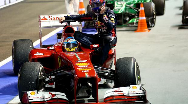 Mark Webber of Australia and Infiniti Red Bull racing is given a lift back to pits by Fernando Alonso of Spain and Ferrari after his engine blew up during the Singapore Formula One Grand Prix at Marina Bay Street Circuit on September 22, 2013 in Singapore