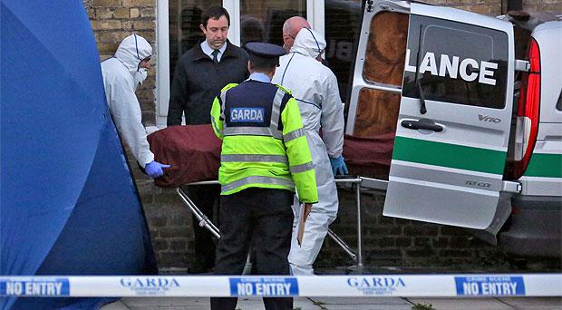 The body of John Maguire is removed from the scene of the fatal stabbing in Ormond Square, Smithfield, in Dublin's north inner city