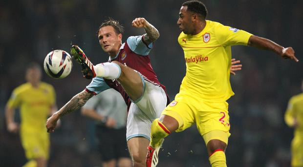 West Ham United's Matt Taylor and Cardiff City's Nicky Maynard (right)compete for the ball
