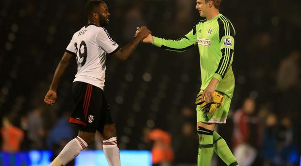 Darren Bent and David Stockdale of Fulham celebrate at the final whistle