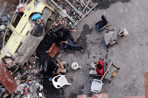 Free Syrian Army fighters rest among debris in Aleppo's Bustan al-Basha district