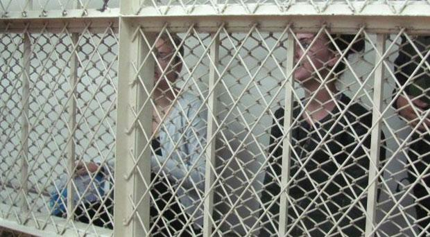 Michaella McCollum Connolly (right) and Melissa Reid in a holding cell during their hearing in Lima, Peru