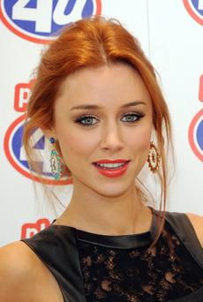 LONDON, UNITED KINGDOM - SEPTEMBER 20: Una Healy of The Saturdays attends a photocall to promote the Phones 4 U Project Upgrade campaign at Phones 4 U on September 20, 2013 in London, England. (Photo by Stuart C. Wilson/Getty Images)