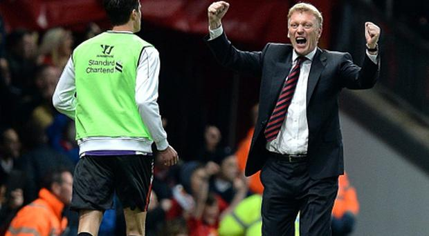 Manchester United manager David Moyes celebrates after Javier Hernandez scored last night's winner