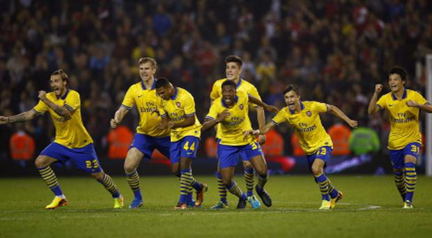 Arsenal players celebrate beating West Bromwich Albion in a penalty shoot out during their English League Cup third round soccer match at the Hawthorns in West Bromwich, central England, September 25, 2013. REUTERS/Darren Staples (BRITAIN - Tags: SPORT SOCCER)