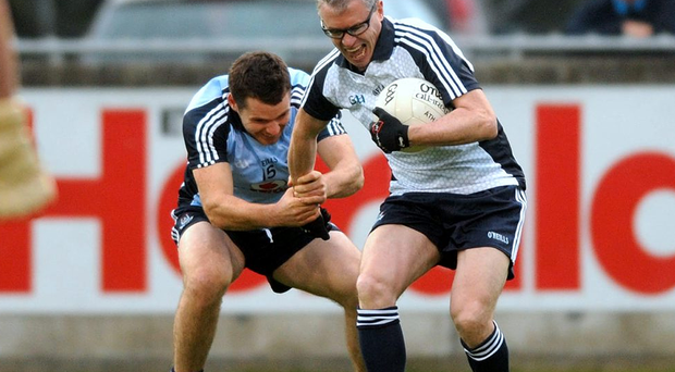 Kevin McMenamin and Joe Brolly in action during the Dublin Footballers Challenge match. Parnell Park, Dublin.