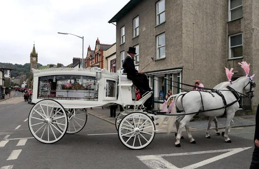 The coffin of April Jones arrives at St Peter's Church, Machynlleth, ahead of her funeral service