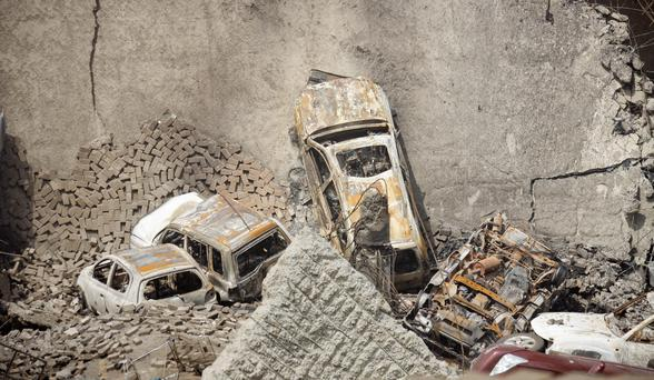 Cars covered in debris in the car park of the Westgate Mall in Nairobi