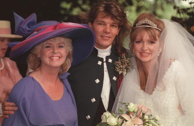 The late Caron Keating (right) with her mother Gloria Hunniford after marrying her manager Russ Lindsay at St. Peter's Church, Hever, Kent in 1991. PA Photo: Malcolm Croft