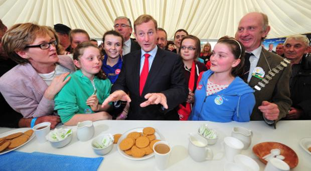 Taoiseach Enda Kenny prepares to partake in tea and biscuits in the Fine Gael tent on the final day of the National Ploughing Championships