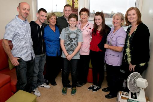 Mark and Ann Curtin (mum and Dad) with surviving Quads Shane Mark and Megan with younger brother Ryan (12) and nurses in the Coombe who were working with them when they were born Margaret Moynihan,Barbara Whelan and Mary Ryan