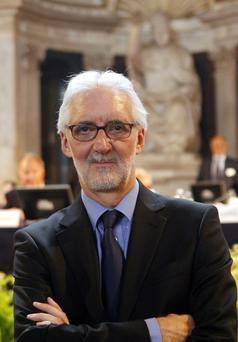Brian Cookson, of Britain, poses for photographers just after being elected president of the UCI in Florence today