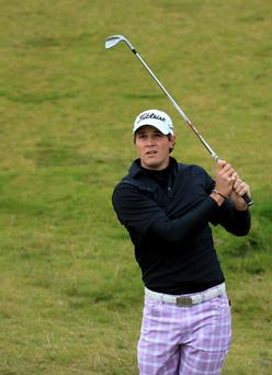 Peter Uihlein of the United States plays his second shots at the par 4, 10th hole during the second round of the 2013 Alfred Dunhill Links Championship at the Kingsbarns Golf Links