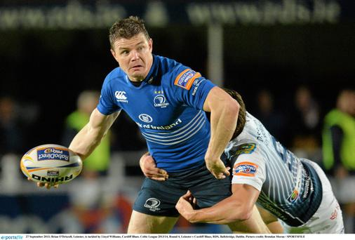 Brian O'Driscoll, Leinster, is tackled by Lloyd Williams