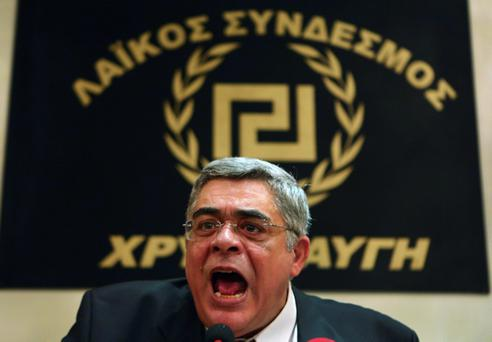 Leader of extreme-right Golden Dawn party Nikolaos Mihaloliakos talks at a news conference in Athens, in this file picture taken May 6, 2012. Greek police arrested Mihaloliakos and the spokesman of the far-right Golden Dawn party on September 28, 2013 on charges of founding a criminal organisation, and have issued arrest warrants for dozens more party members and lawmakers, police officials said. REUTERS/Yannis Behrakis/Files (GREECE - Tags: POLITICS ELECTIONS CRIME LAW)