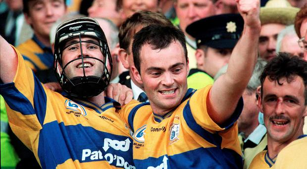 Guinness All Ireland Hurling Final 1997. Clare'a Sean McMahon celebrates with team captain Anthony Daly after the final whistle