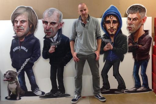 The gang's all here - Dublin artist Niall O'Loughlin with his Love/Hate artworks