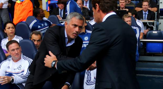 Andre Villas-Boas manager of Tottenham Hotspur (R) shakes hands with Jose Mourinho manager of Chelsea prior to the Barclays Premier League match between Tottenham Hotspur and Chelsea at White Hart Lane