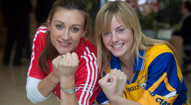 Clare supporter Orla O'Callaghan with colleague and Cork supporter Tracy Egan in Laya Healthcare Cork
