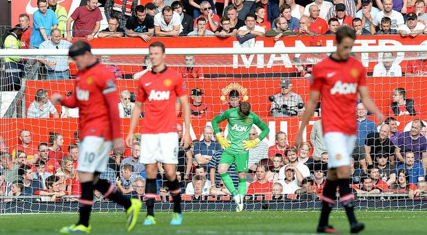Manchester United's players including goalkeeper David De Gea (centre) stand dejected after West Bromwich Albion score