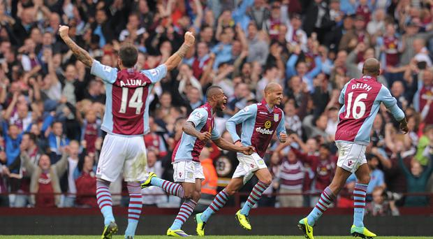 Aston Villa's Leandro Bacuna (centre) celebrates scoring his side's second goal during the Barclays Premier League match at Villa Park