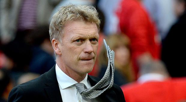 Manchester United manager David Moyes leaves the pitch after his teams 2-1 defeat to West Bromwich Albion