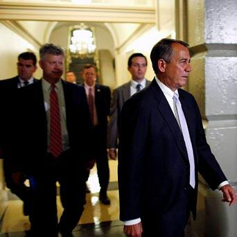 U.S. House Speaker John Boehner (R-OH) arrives for a late night closed-door meeting of the House Republican caucus during a rare Saturday session at the U.S. Capitol in Washington, September 28, 2013.