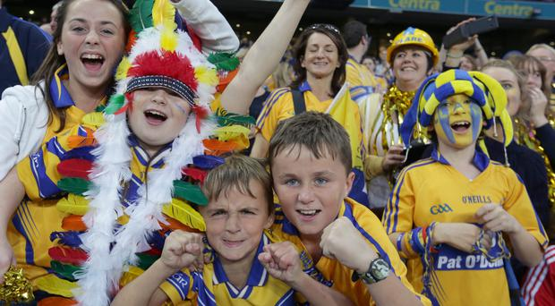 Clare supporters celebrate victory over Cork in the All Ireland Hurling Final Replay at Croke Park, Dublin