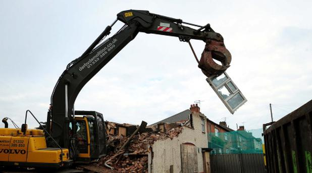 Demolition work begins on Mick and Mairead Philpott's old family home on Victory Road, Derby, where the two parents set a deadly fire which killed their children. PRESS ASSOCIATION Photo. Picture date: Monday September 30, 2013. Demolition began just after 8am at the fire-damaged semi-detached house in a clearance expected to last several days. See PA story FIRE House. Photo credit should read: Rui Vieira/PA Wire