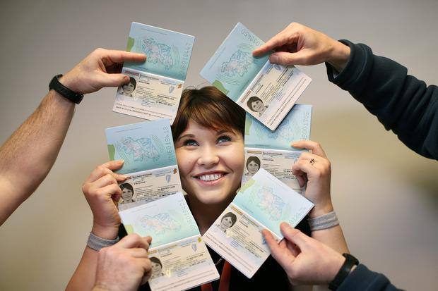 Newly designed Irish Passport featuring iconic images of Ireland is launched in Dublin. Picture shows Dublin Passport Office worker Karen Griffin who was the face of the 'test run' of new passports aka 'Lauren O Sullivan ' surrounded by specimen copies of the new passport at the printing room in the Passport Offices,Dublin