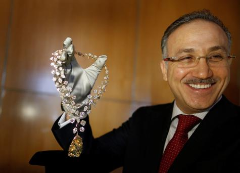 Managing Director of Mouawad Boutique, Jean Nasr shows off the rose gold necklace with a €40m price tag