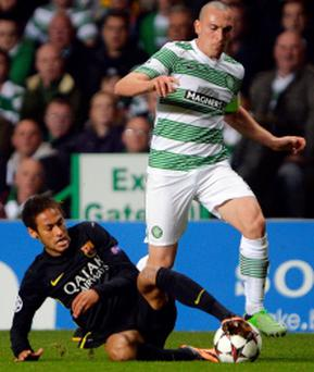 Celtic's Scott Brown (R) fouls Barcelona's Neymar to earn his red card