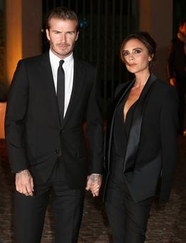 David Beckham and Victoria Beckham attends an evening celebrating with The Global Fund featuring the first green carpet challenge at Apsley House on September 16, 2013 in London, England. (Photo by Chris Jackson/Getty Images)...E