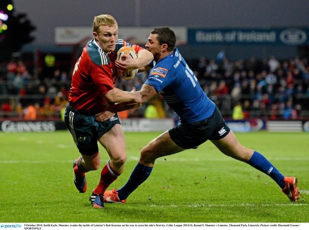 Keith Earls, Munster, evades the tackle of Leinster's Rob Kearney on his way to score the game's only try