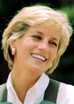 Princess Diana photo dated 15/01/1997 of Diana, Princess of Wales, laughs during her visit to a minefield at Huambo in Angola. PRESS ASSOCIATION photo.
