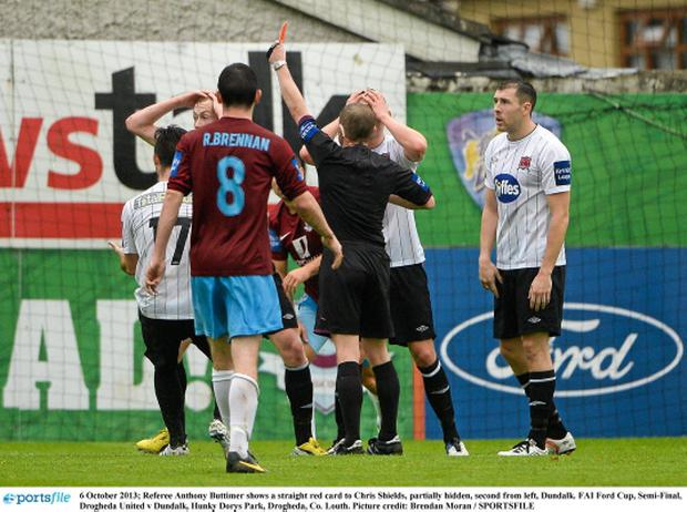 Referee Anthony Buttimer shows a straight red card to Chris Shields