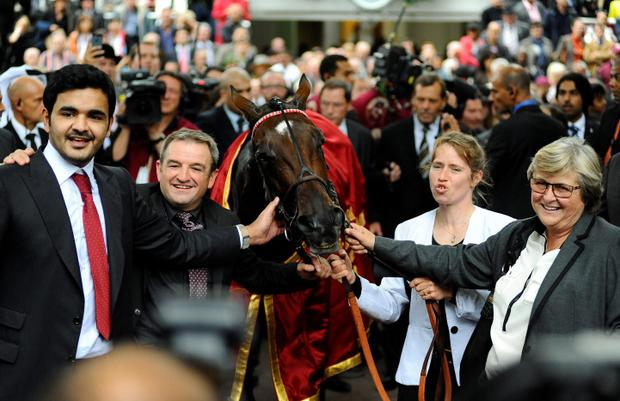 Sheikh Joaan Al Thani (L), owner of Treve, and trainer Criquette Head-Maarek (R) after winning the Prix de l'Arc de Triomphe at Longchamp racecourse