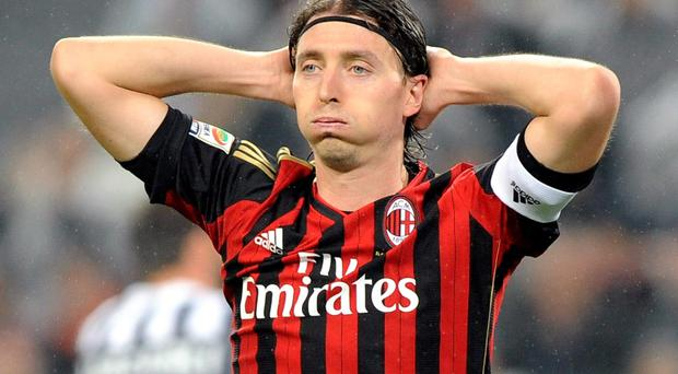 AC Milan's Riccardo Montolivo rues a miss during the Italian Serie A soccer match against Juventus at the Juventus stadium in Turin on Sunday. Milan supporters have been accused of abusive chants during the match