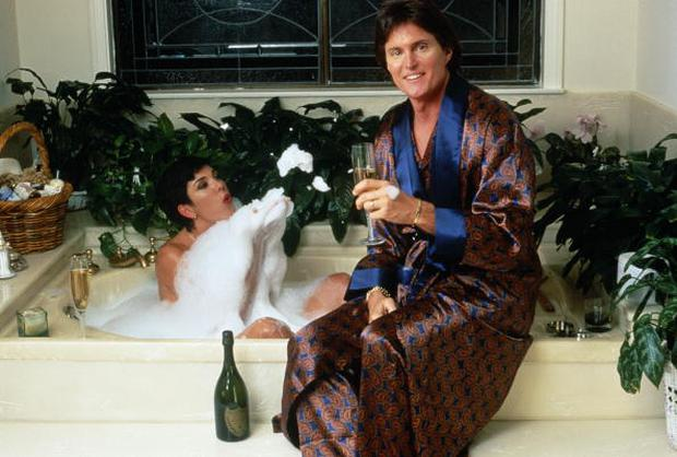 US athlete Bruce Jenner and his partner Kris Jenner, formerly Kris Kardashian, share a bottle of Dom Perignon over a bubble bath, circa 1991. (Photo by Maureen Donaldson/Getty Images)