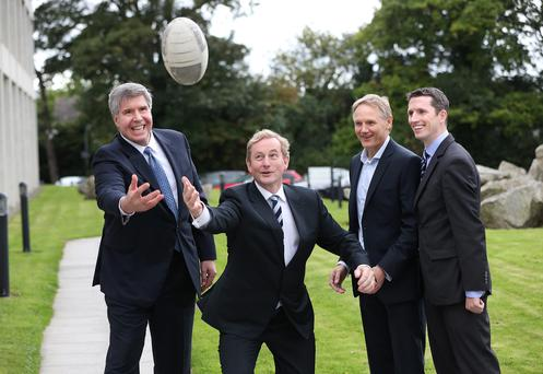 Taoiseach Enda Kenny TD (centre) joins Irish Rugby Coach Joe Schmidt and Dr Simon Boucher CEO IMI (right) and Herb Hribar CEO Eircom Group (left) at the IMI National Management Conference 2013,IMI Sandyford