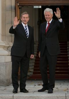 Taoiseach Enda Kenny TD , greets President Bill Clinton during a meeting between the two at Government Building in October