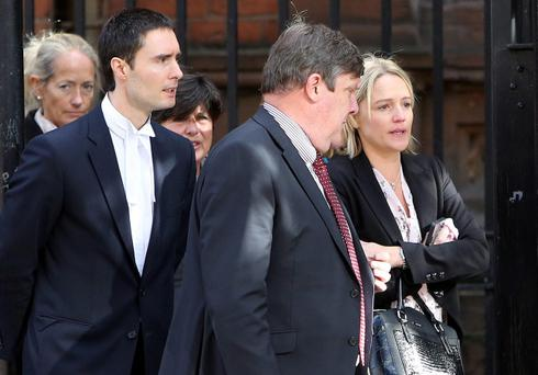 Samatha Bennett (right), the mother of 20-month-old Liam Gonzales Bennett, leaves court with family and legal representatives after an inquest into his death at the Coroners' court, Belfast.