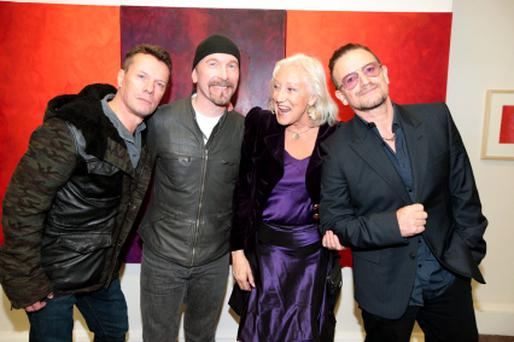 Anne Madden with U2's Bono,The Edge and Larry Mullen at the opening of her exhibition of art at the Taylor Galleries on Kildare Street, Dublin. (Picture:Arthur Carron/Collins)