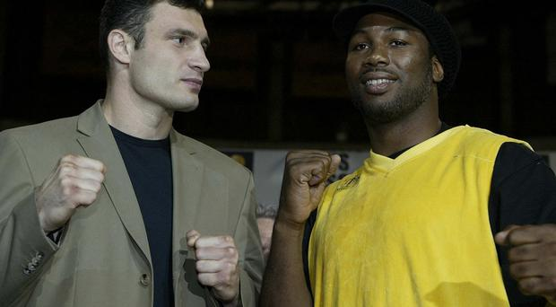 Flashback: Lennox Lewis (right) with Ukrainian challenger Vitali Klitschko before their bout in 2003